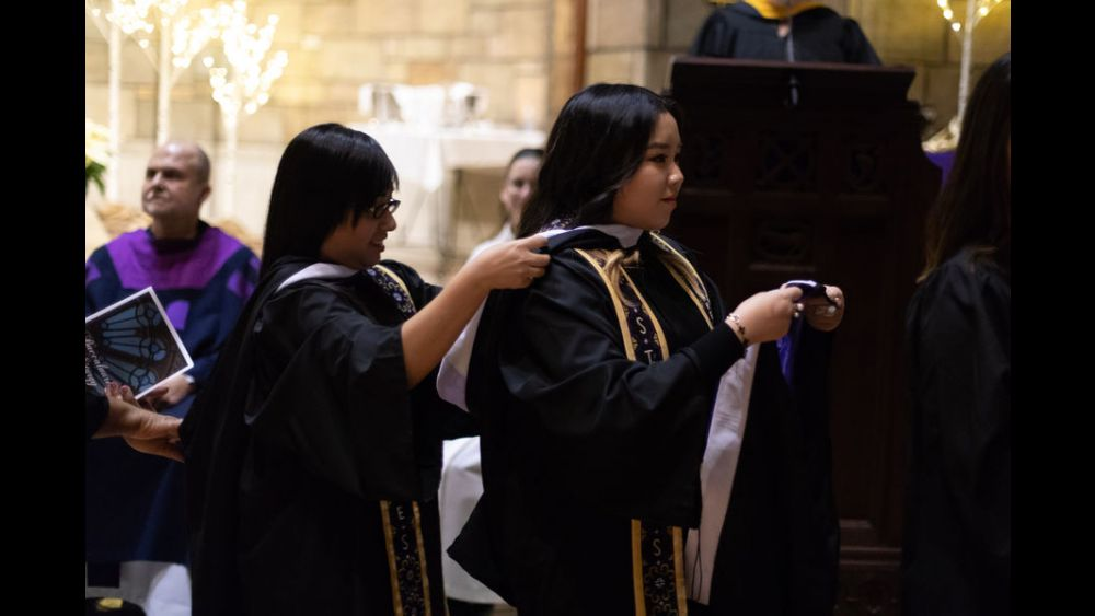 Hooding ceremony in Our Lady of Victory Chapel
