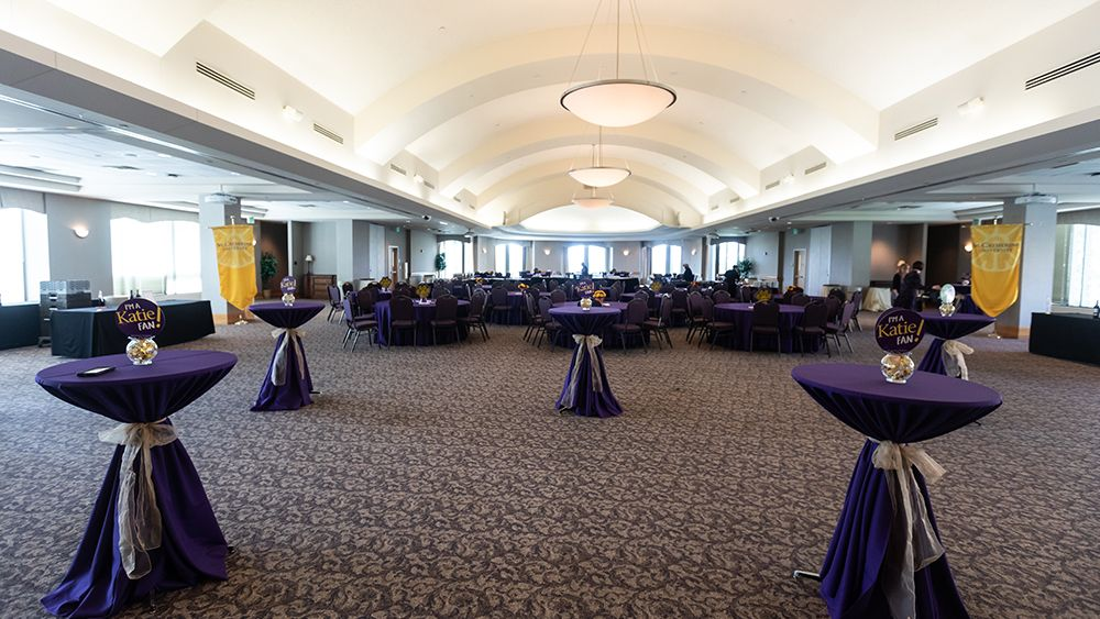 Ballroom set for a reception with standing tables
