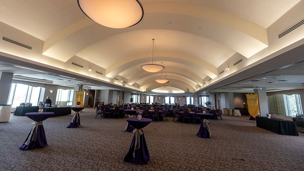 Ballroom set up with standing tables and round tables and chairs