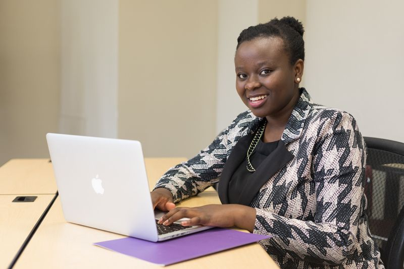 Master of organizational leadership (MAOL) student at her laptop