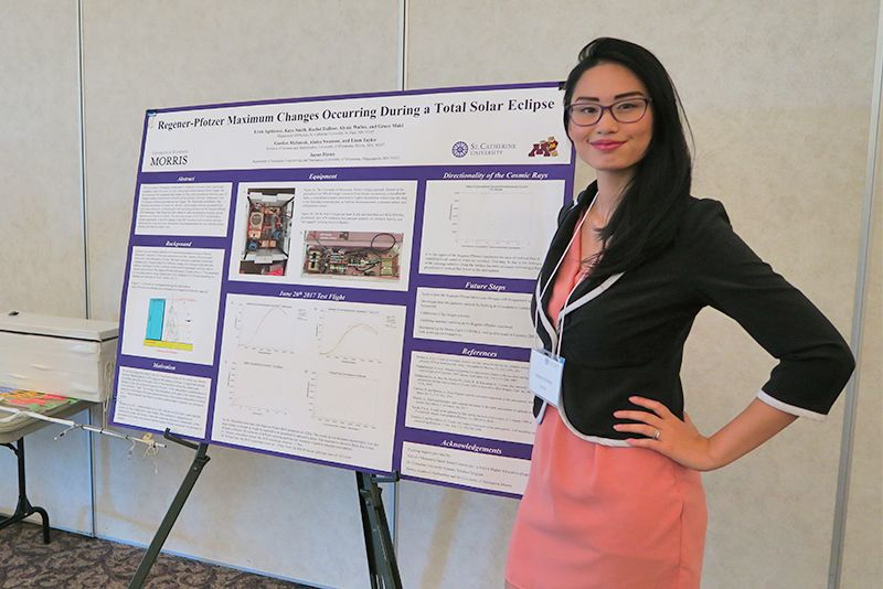 Physics major student presenting a poster of research at St. Catherine University.