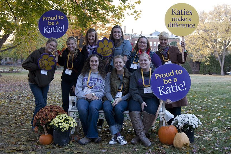 Alumni pose on campus at Katiefest