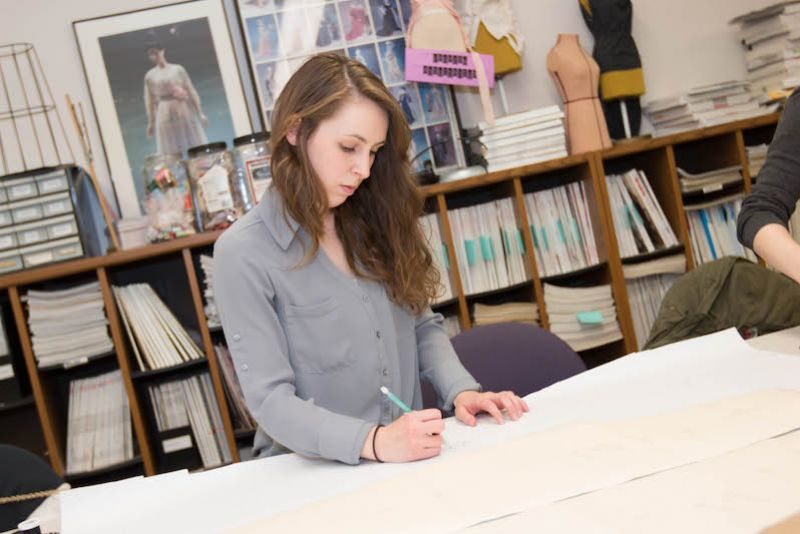 Student works on a fashion merchandising and apparel design project