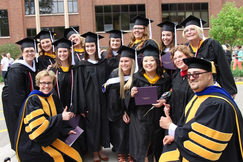 Communication Studies faculty with graduating students in 2014.