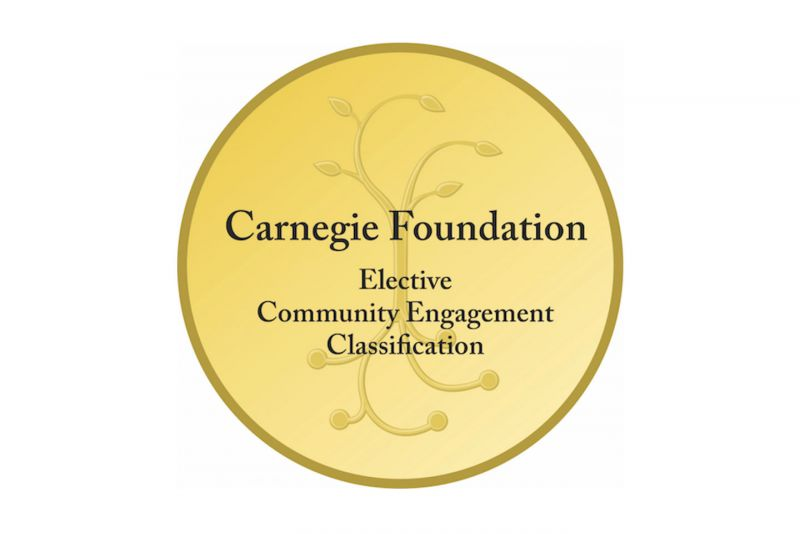 "Golden seal with words ""Carnegie Foundation Elective Community Engagement Classification"" written on it in black font."