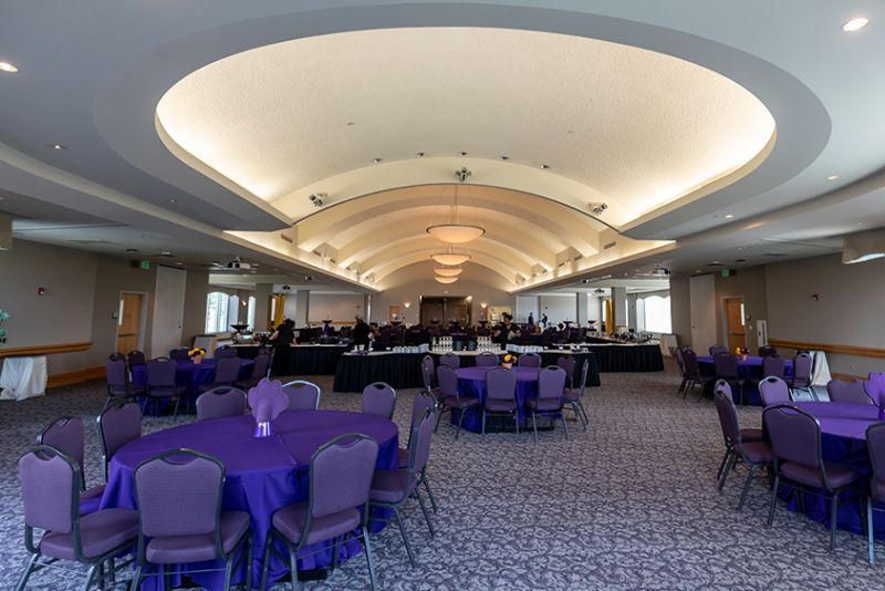 Ballroom set up with round tables and chairs
