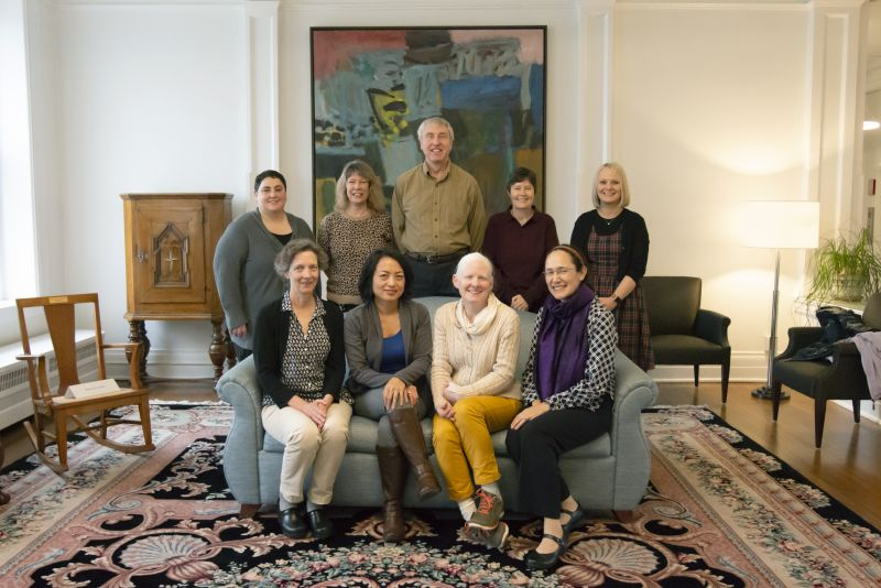 Group of social work department faculty in Derham Parlor