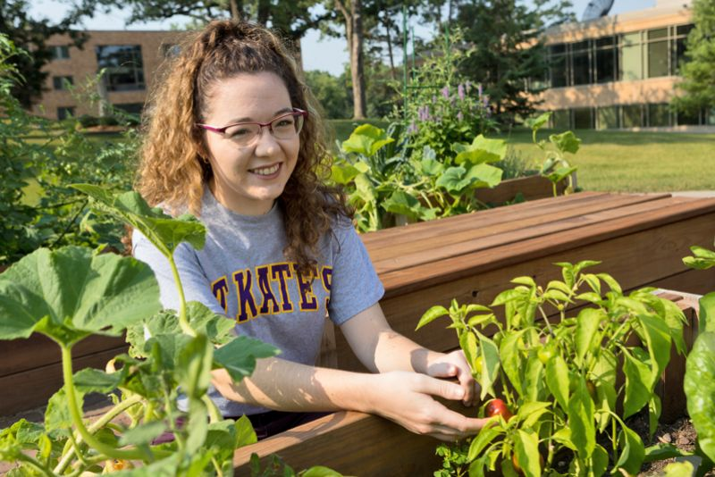 Honors student Natalie Nation in St. Kate's community garden