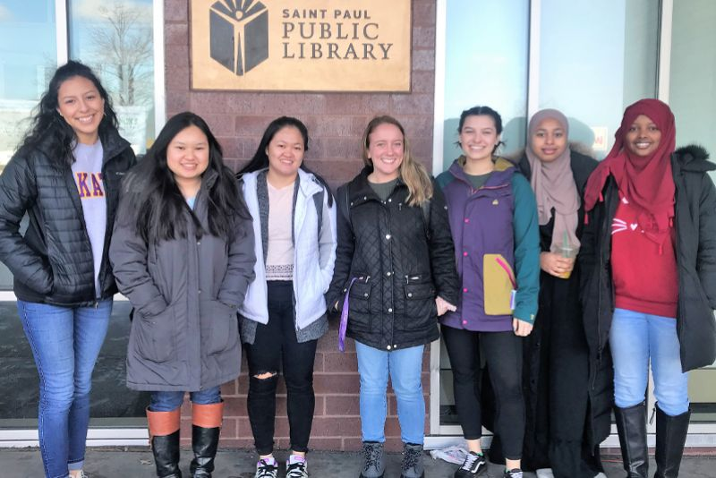 Community Work and Learning students stand in front of Rondo Community Library in St. Paul, MN