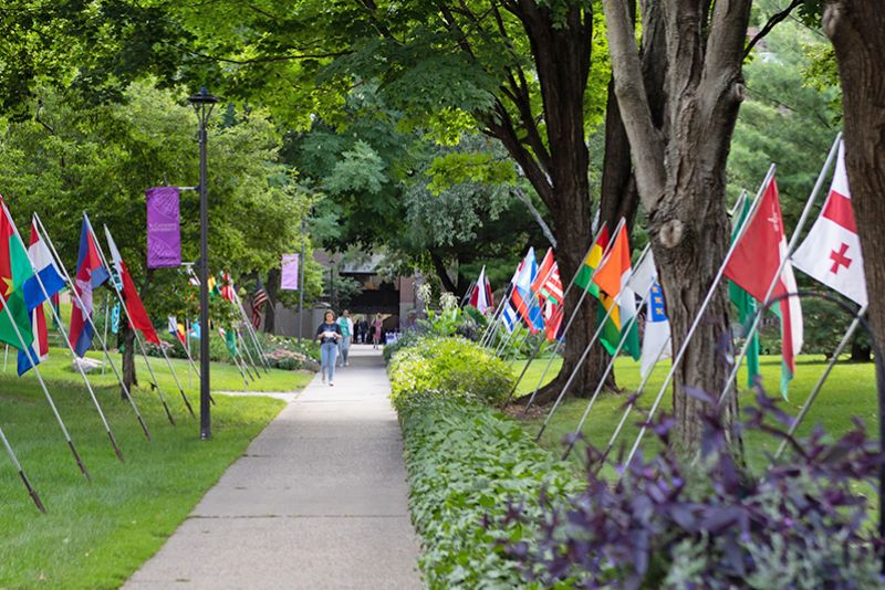 Pathway lined with various countries' flags on St. Catherine University's St. Paul, MN campus.