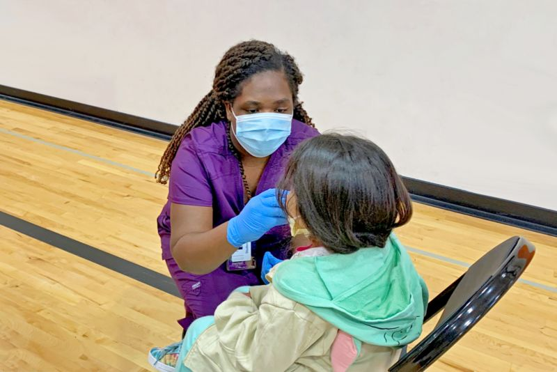 Katilyn Taylor, MSN-EL'22, Administers Flu Vaccine To An Elementary School Student During Her Clinical Work At The Bear Care Health And Wellness Clinic In The White Bear Lake School District.