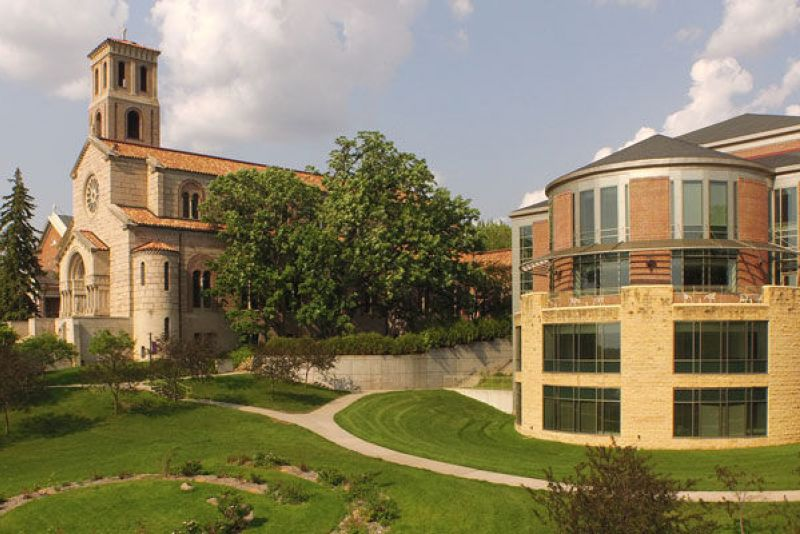 Landscape shot of St. Kate's campus, including chapel and Couer de Catherine buildings.