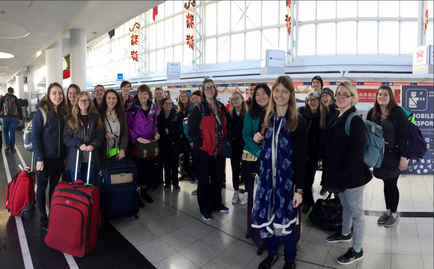 Away we go: Professor Emily West (third from right, in blue) with Nepal-bound students. Photo by Jeff Johnson.