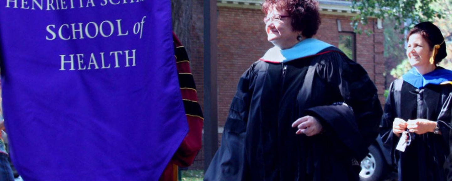 Photo of Penelope Moyers (then Associate Provost and Dean of the Henrietta Schmoll School of Health) at convocation.