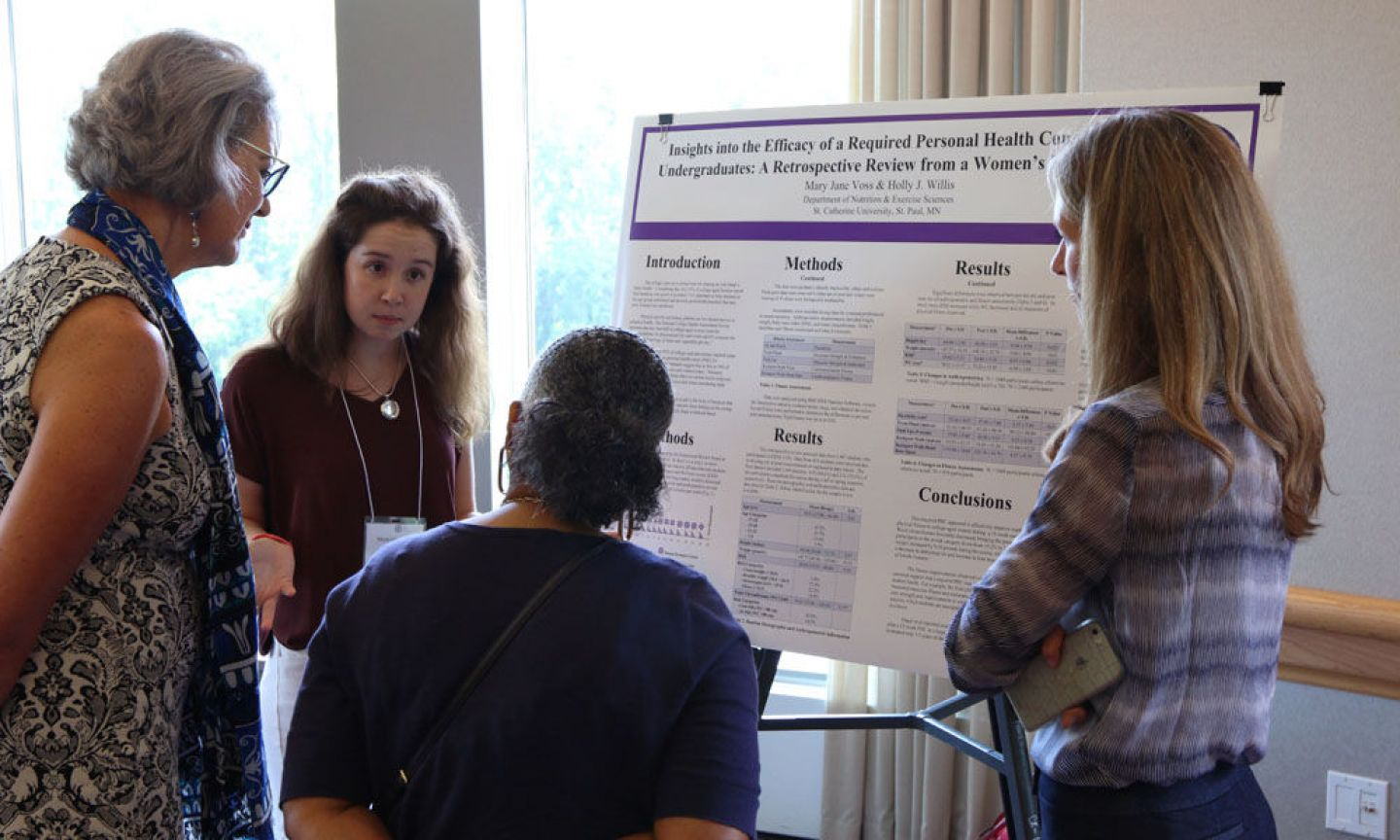 Students presenting their research poster at the 2017 Summer Scholars Showcase. Photo by Amy Mullowney '19