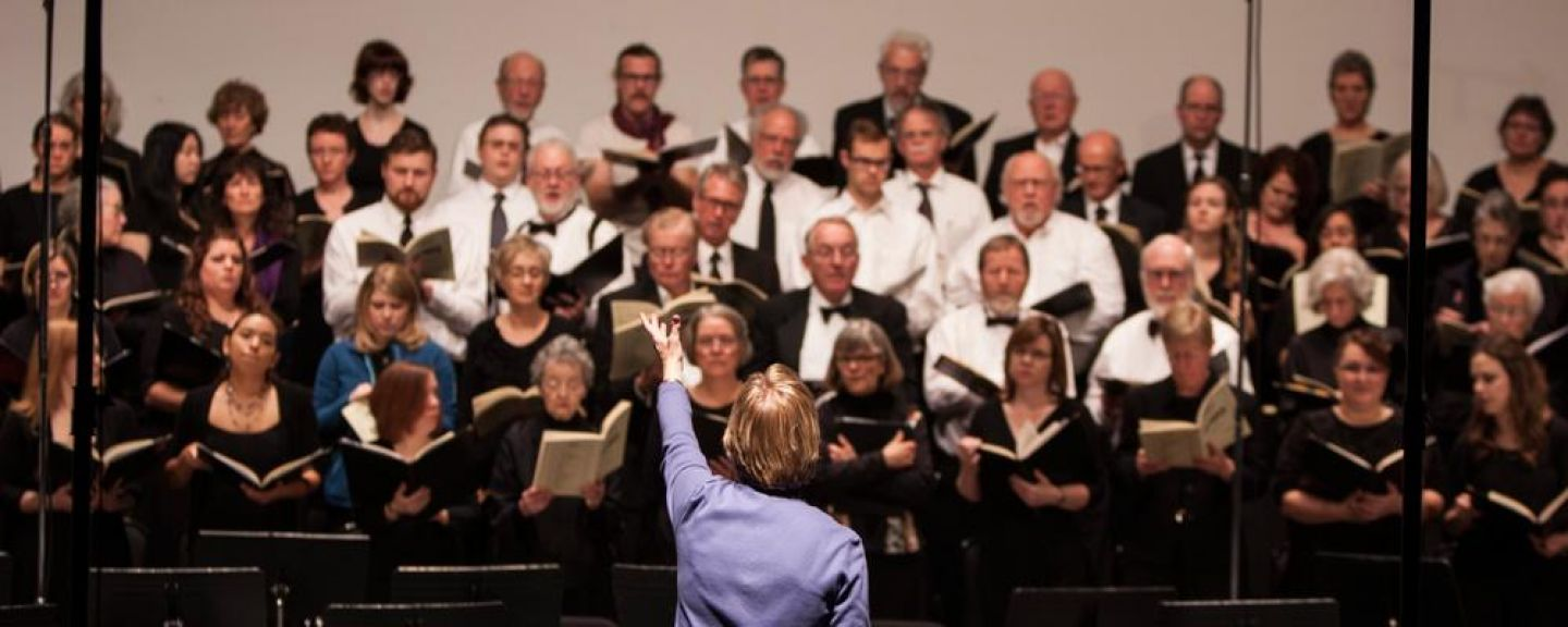 "Patricia Connors conducts the St. Catherine Choral Society during their 2013 concert, ""Sing for Joy."" Photo by Hilary Stein '14."