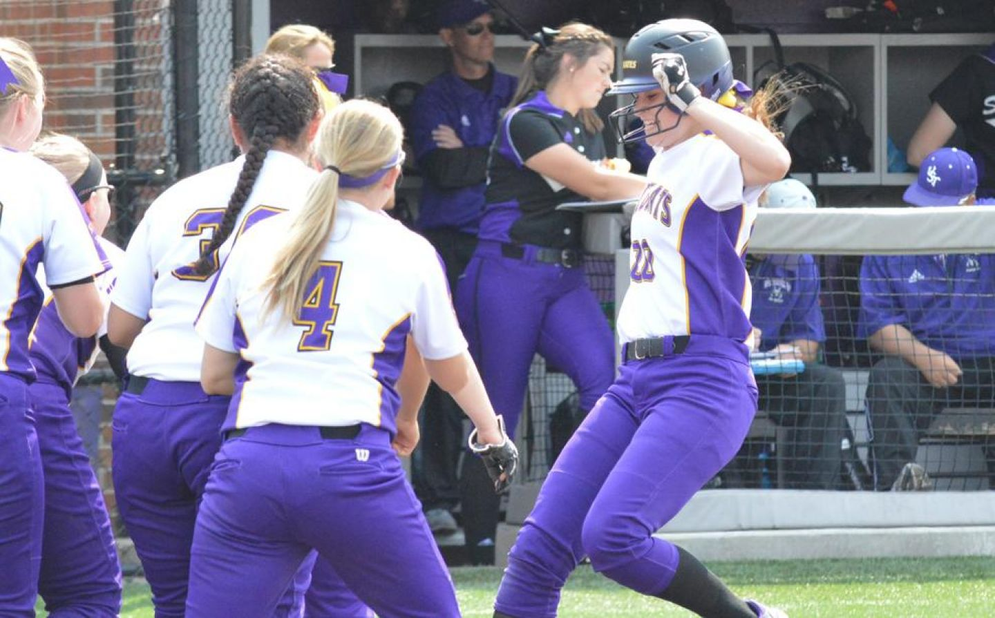 Megan Lindenfelser '18 hits home plate following a home run during the first game against St. Thomas Sunday, May 8, 2016. Photo by Matt Higgins, MIAC.