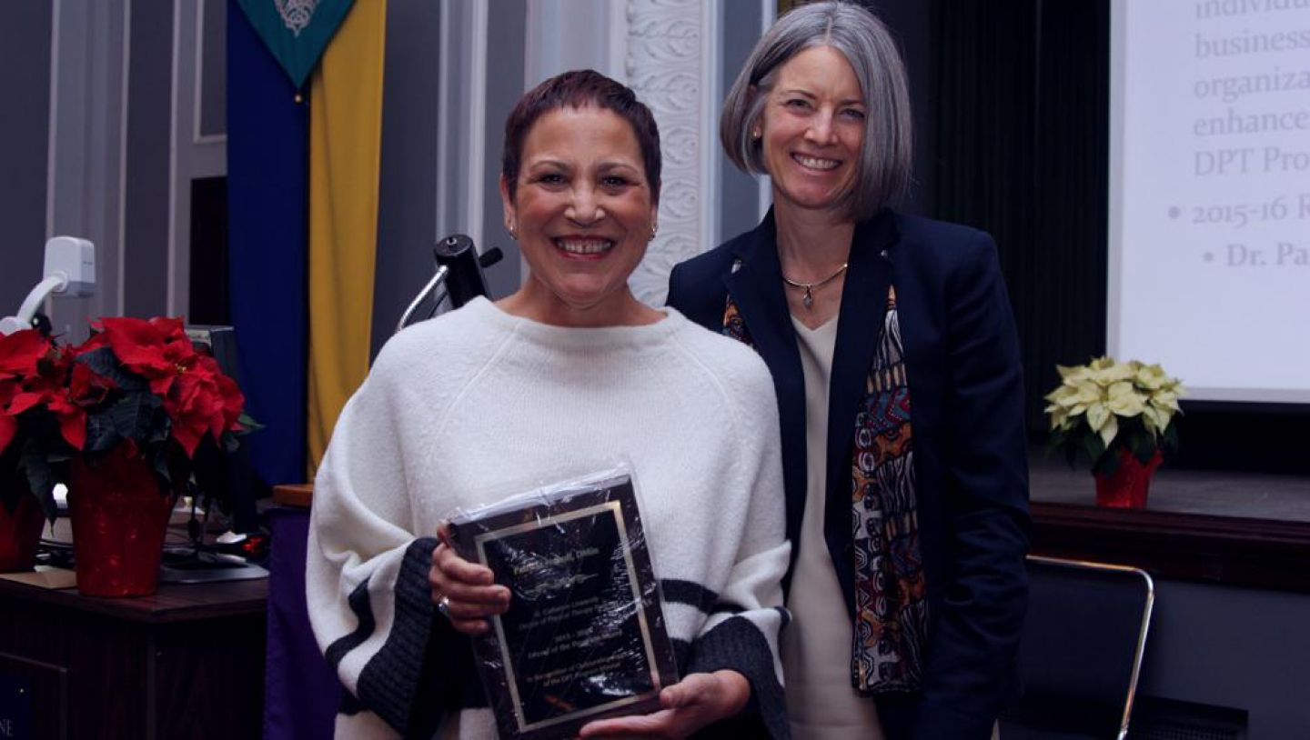 "Patricia Nanoff, professor of Liberal Arts and Sciences is pictured here with DPT Program Director Lisa Dutton. On DPT Research Day in December 2015, Dr. Nanoff was honored with the Friend of the Program Award. ""We are indebted to Dr. Nanoff for her work with our program relative to the integration of Catholic social teaching into our curriculum,"" says Dutton."