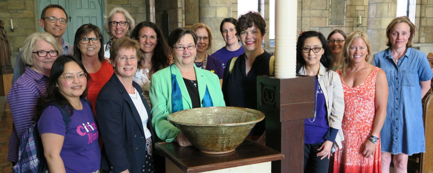 Representatives from the University Faculty Council honored President Andrea Lee, IHM, for her service to St. Catherine Universityby dedicating a baptismal font for use in Our Lady of Victory Chapel. Photo by Sharon Rolenc.