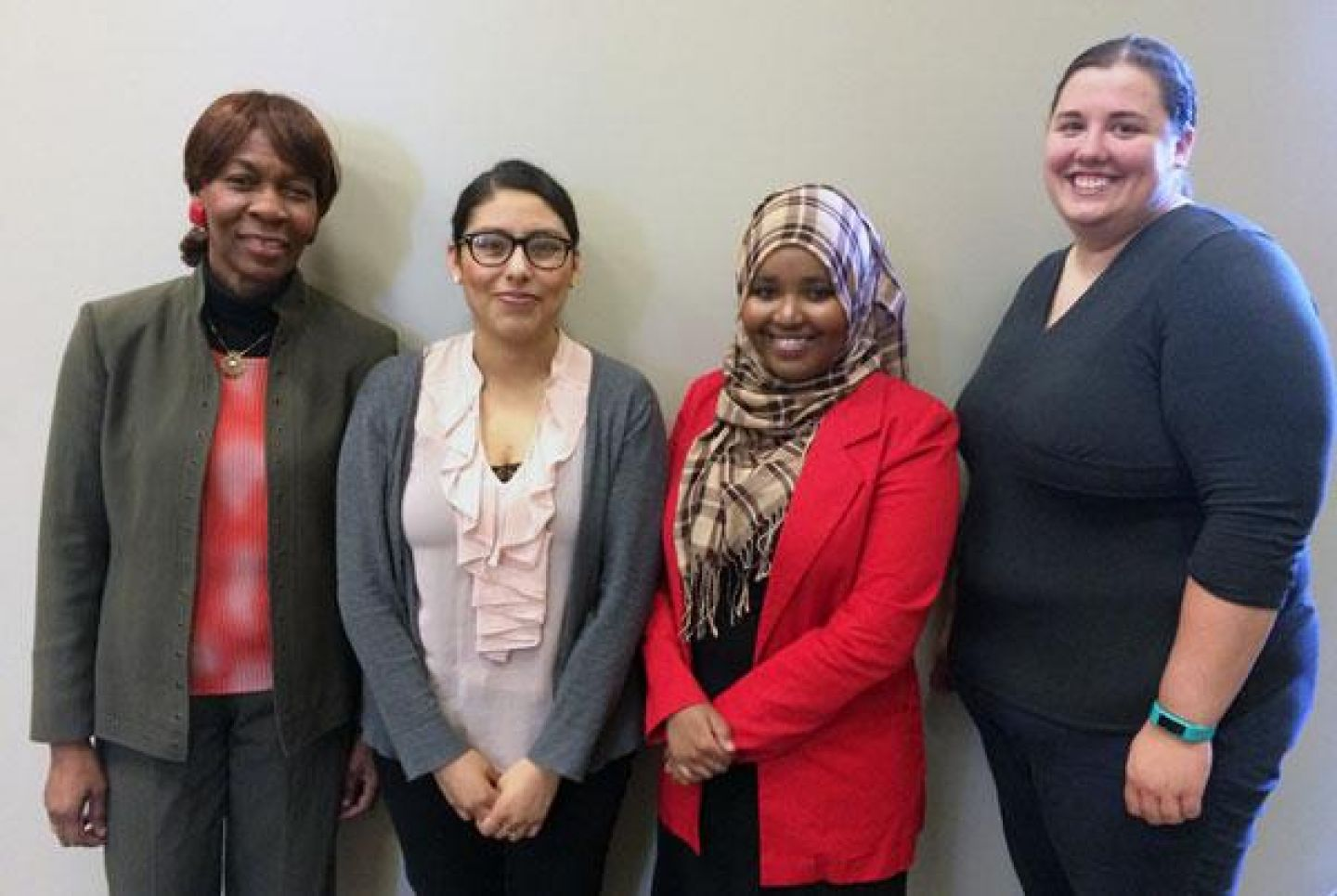 Thelma Obah, Laura Mena '16, Ikram Koliso '17 and Elizabeth Steffen collaborated on the Emerging Scholars Study Advocates program. Photo by Sharon Rolenc.