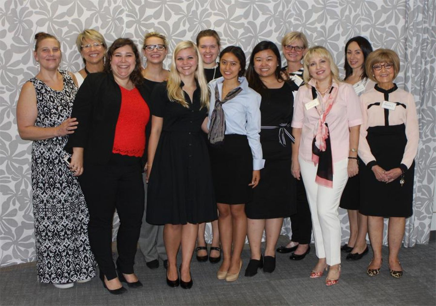 Career Ready interns, their new business attire and the image coaches who suited them. Photo includes Dress for Success spokesperson Lily Lamb. Photo by Jaelyn Miltz '20.