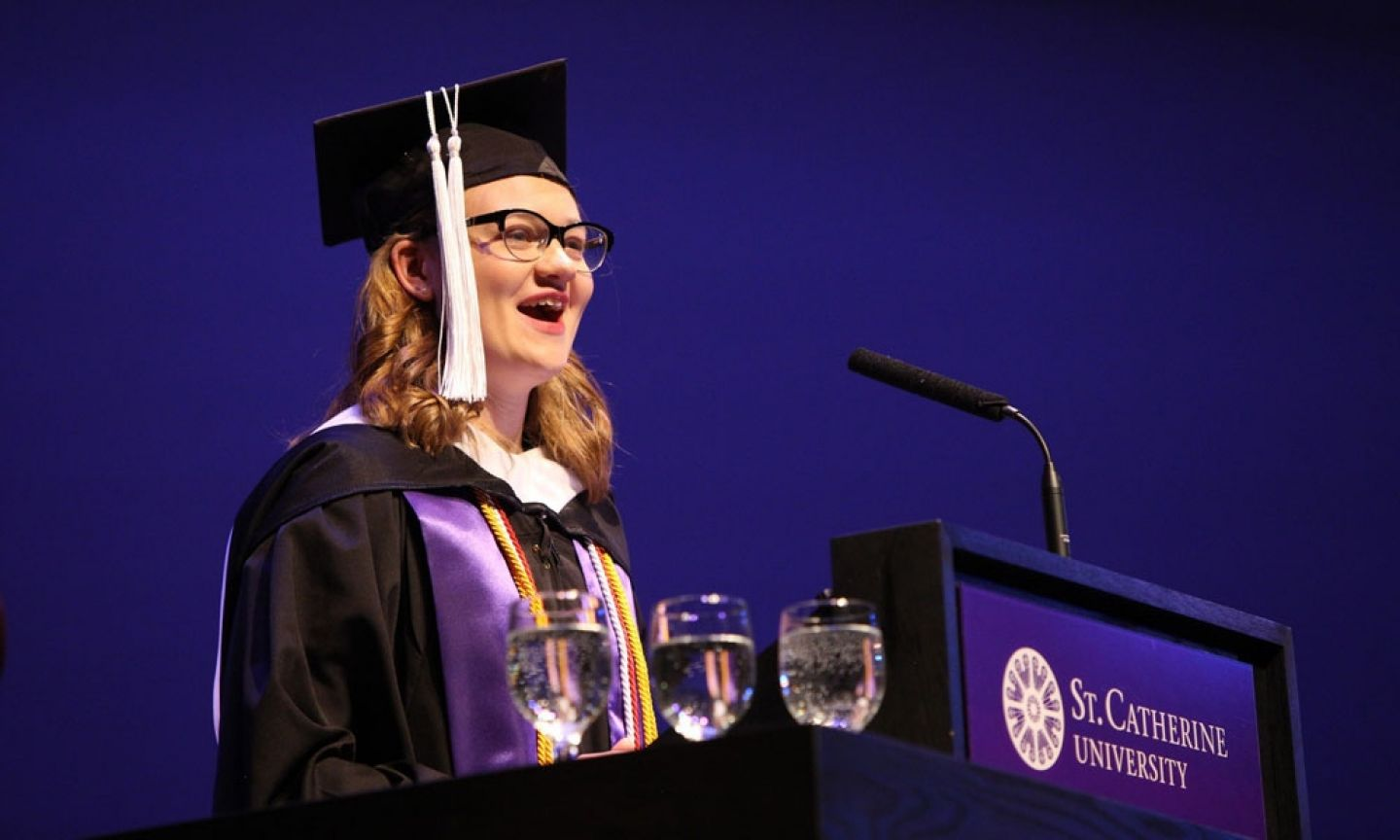 "Lauren Crepeau '16 delivers a heartfelt winter commencement address on leadership and social justice on December 21, 2016. A double major in communication studies and English, with a minor in women's studies, Crepeau is a DupliKate and the fourth in her family to attend St. Kate's. After graduation, Crepeau intends to ""move people to action"" and always stand for social justice. Photo by Rebecca Zenefski '10 / By Rebecca Studios"